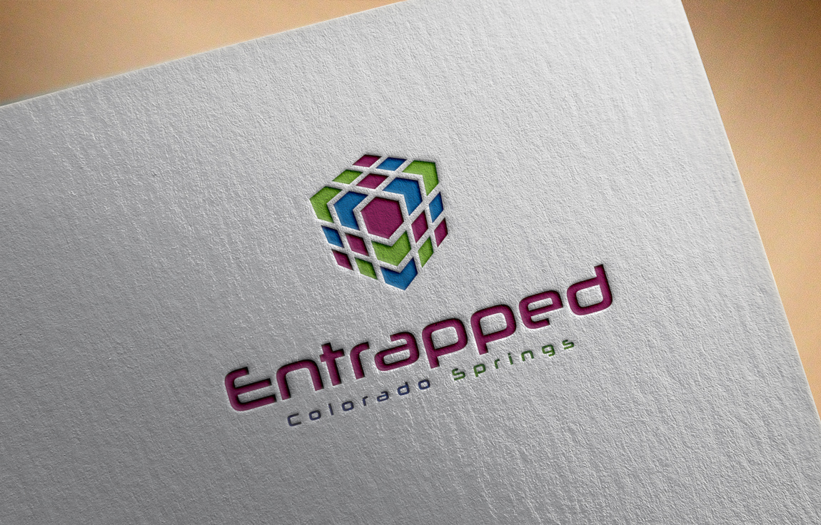 Elegant playful business logo design for entrapped for T shirt printing in colorado springs