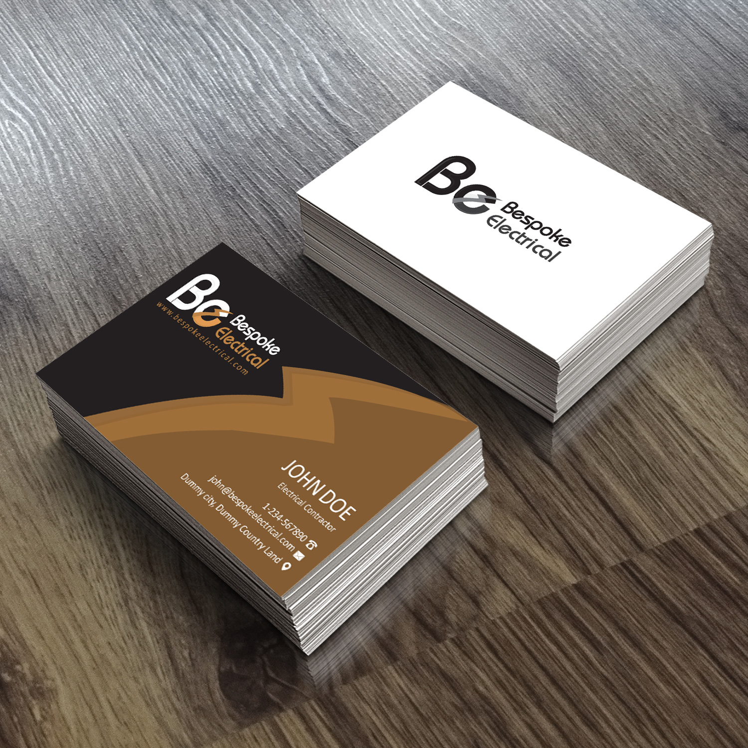 bold modern business card design for bespoke electrical inc by